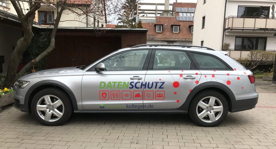 Seitenansicht eines silbernen Audi A6 mit neuer Fahrzeugfolierung für Brunner und Schmidt