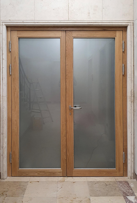 Vollflächig folierte Glastüren mit Holzrahmen